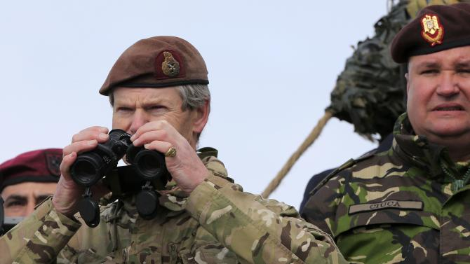 "British Lieutenant-General Bradshaw, the current Deputy Supreme Allied Commander Europe uses binoculars next to Romanian Lieutenant General Ciuca during the ""Wind Spring 15"" military exercises at Smardan shooting range"