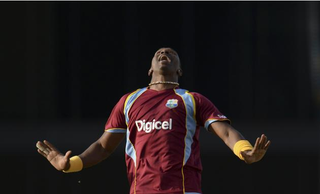 West Indies' Bravo shouts as he prepares to catch England's Bopara during the first T20 international cricket match at Kensington Oval in Bridgetown