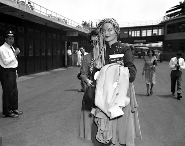 Sporting a flashy turban, Doris Duke Rubirosa arrives at LaGuardia Field. She denied rumors that she and her hubby, Dominican diplomat Rubirosa, would part. (Photo by Art Edger/NY Daily News Archive via Getty Images)
