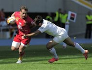 Stade Toulousain Yannick Jauzion (R) tackles Perpignan&#39;s Hume Gavin (L) during the French Top 14 Rugby Union match at the Olympic Stadium Lluis Companys in Barcelona. Perpignan put their poor start to the Top 14 campaign behind them as they humbled champions Toulouse 34-20, grabbing an offensive bonus point in the process