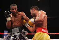 File photo shows Lamont Peterson (L) and Amir Khan during their WBA Super Lightweight and IBF Junior Welterweight title fight on December 10. The International Boxing Federation has ruled that Peterson will be allowed to keep the junior welterweight title he won against Khan