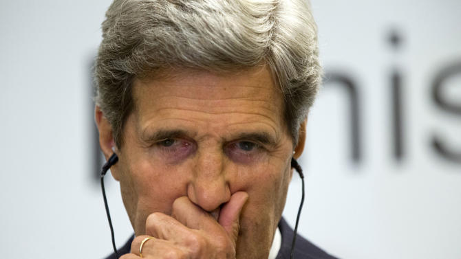 U.S. Secretary of State John Kerry listens to a question during a news conference with Qatari Prime Minister and Foreign Minister Hamad bin Jassim Al Thani, not pictured, at a news conference about Syria in Doha, Qatar, on Saturday, June 22, 2013. (AP Photo/Jacquelyn Martin, Pool)
