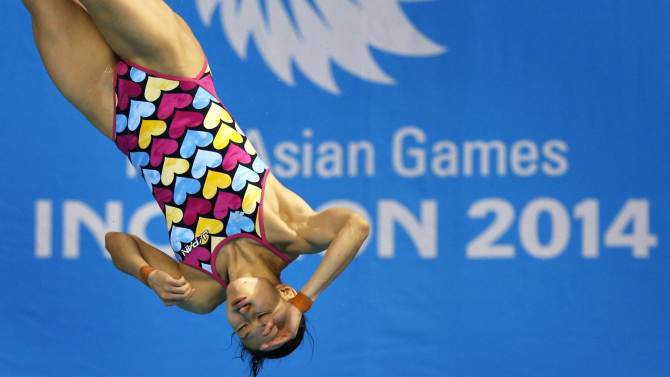 Japan's Shibusawa competes in the Women's 1m Springboard diving final during the 17th Asian Games in Incheon