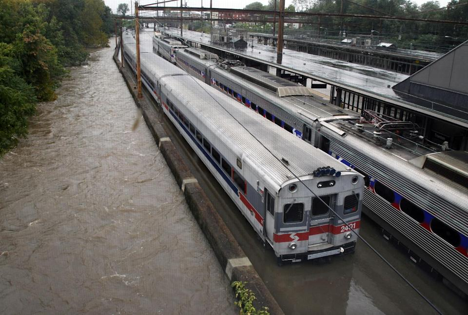 Two Southeastern Pennsylvania Transportation Authority trains sit in water on flooded tracks at Trenton train station Sunday, Aug. 28, 2011, in Trenton, N.J., as rains from Hurricane Irene are causing inland flooding of rivers and streams. (AP Photo/Mel Evans)