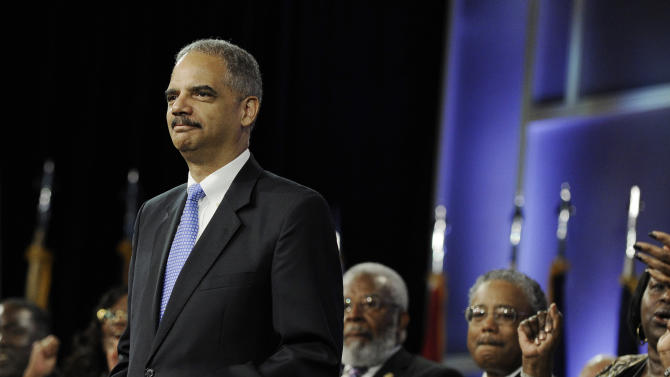 Attorney General Eric Holder is welcomed at the NAACP annual convention Tuesday, July 10, 2012, in Houston. Holder says he opposes a new photo ID requirement in Texas elections because it would be harmful to minority voters. (AP Photo/Pat Sullivan)