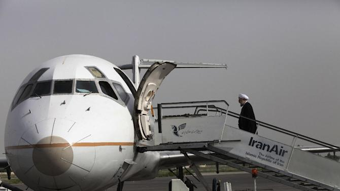 """In this Monday, June 10, 2013 photo, Iranian President elect, Hasan Rouhani, a former Iran's top nuclear negotiator, boards his plane leaving northwestern city of Oroumieh to the city of Tabriz, during his presidential election campaign tour to the northwestern, Iran. Just a week before Iran's election gatekeepers announced the presidential ballot, Rouhani described the U.S. as the world's """"sheriff"""" and said direct talks with Washington are the only way for breakthroughs in the nuclear standoff. (AP Photo/Vahid Salemi)"""