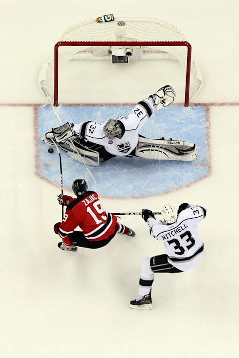  Jonathan Quick #32 Of The Los Angeles Kings Makes A Save In Front Of Travis Zajac #19 Of The New Jersey Devils And  Getty Images