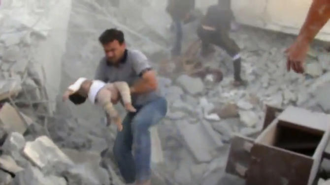 In this image taken from video obtained from Shaam News Network (SNN), which has been authenticated based on its contents and other AP reporting, a young child is rescued from the rubble of a building destroyed by government airstrike in Azaz, Syria, Friday, Sept. 28, 2012. A Syrian activist group, the Local Coordination Committees, said a Syrian warplane bombed the northern town of Azaz near the Turkish border, killing several people. (AP Photo/Shaam News Network SNN via AP video)