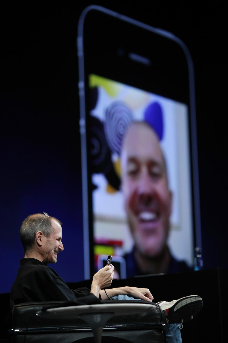 In this June 7, 2010 photo shows Apple CEO Steve Jobs with an iPhone using FaceTime with Jonathan Ive, Apple senior vice president of Industrial Design, at the Apple Worldwide Developers Conference, in San Francisco. (AP Photo/Paul Sakuma)