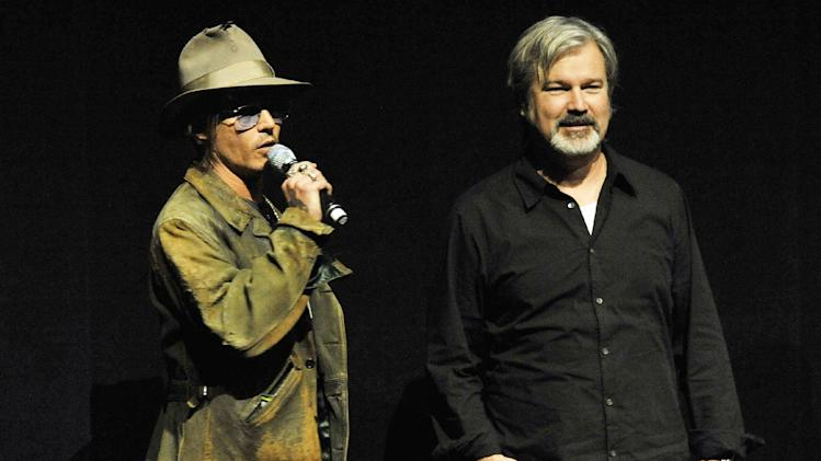 "Johnny Depp, left, who plays Tonto in the upcoming film ""The Lone Ranger,"" speaks to the audience as the film's director Gore Verbinski looks on during the Walt Disney Studios presentation at CinemaCon 2013 at Caesars Palace on Wednesday, April 17, 2013 in Las Vegas. (Photo by Chris Pizzello/Invision/AP)"