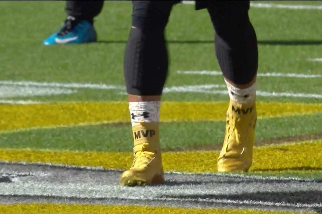 Cam Newton is wearing gold 'MVP' cleats during Super Bowl warmups