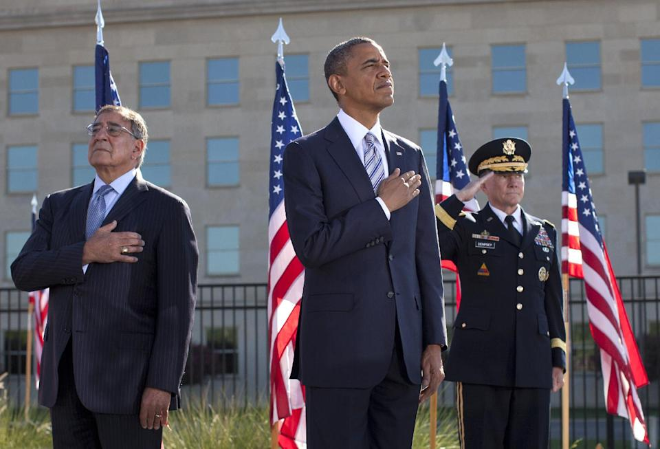 President Barack Obama, flanked by Defense Defense Leon Panetta, left, and Joint Chiefs Chairman Gen. Martin Dempsey, place their hands over their hearts at the Pentagon Memorial,Tuesday, Sept. 11, 2012, during a ceremony to mark the 11th anniversary of the Sept. 11 attacks. (AP Photo/Carolyn Kaster)
