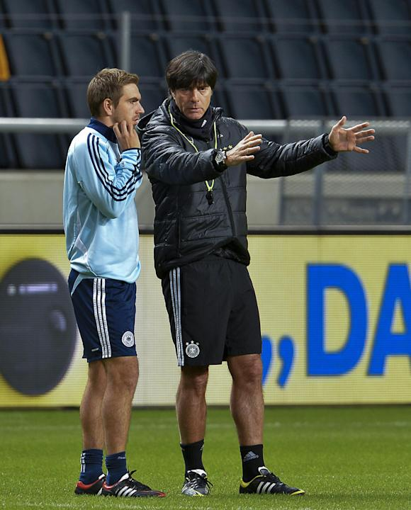 Germany's soccer coach Joachim Loew, right, and captain Philipp Lahm attend a training session at Friends Arena in Stockholm, Sweden, Monday Oct. 14, 2013. Germany will play Sweden in their World Cup