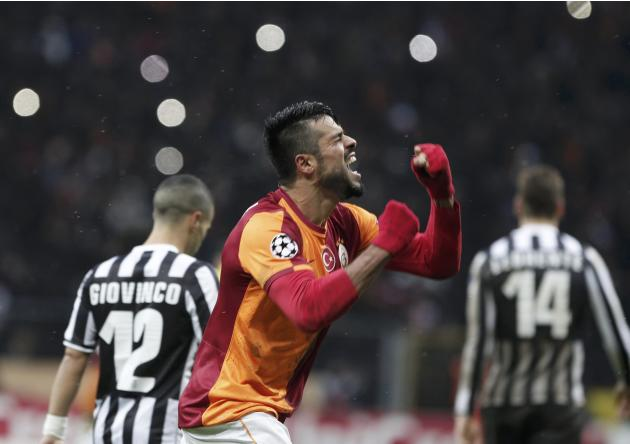 Zan of Galatasaray celebrates his teams victory over Juventus after their Champions League soccer match in Istanbul