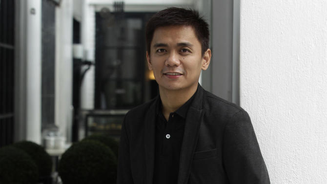 """Filipino writer and director Jun Robles Lana poses after an interview with the Associated Press in suburban Quezon City, north of Manila, Philippines on Wednesday Sept. 26, 2012. Lana's film """"Bwakaw"""", an indie drama that explores the loneliness and missed opportunities of an ailing, 70-year-old gay man has tested the local sensibilities about sexuality and, if it passes the Academy Awards' nomination process, may get a shot as the country's entry for the best foreign-language film next year.(AP Photo/Aaron Favila)"""