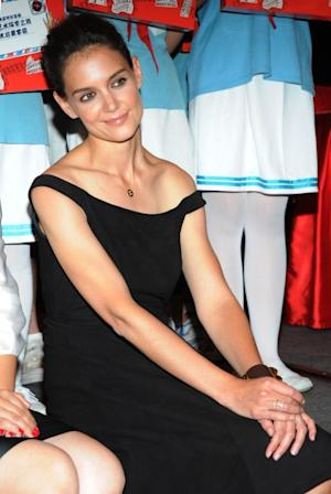 Katie Holmes is all smiles at the 'Artistry on Ice' press conference at Sheraton Hotel in Beijing, China on June 11, 2012 -- Getty Premium