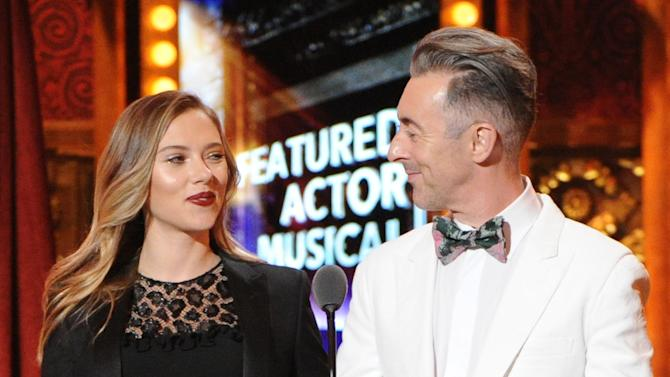 Actress Scarlett Johansson, left, and actor Alan Cumming present the award for Best Performance by an Actor in a Leading Role at the 67th Annual Tony Awards, on Sunday, June 9, 2013 in New York. (Photo by Evan Agostini/Invision/AP)