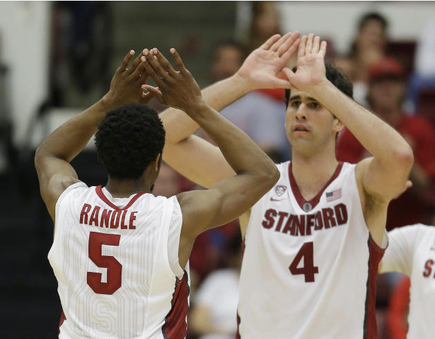 Stanford guard Chasson Randle, left, is greeted by teammate Stefan Nastic, right, after scoring in the second half of an NCAA college basketball game against Utah Saturday, March 8, 2014, in Stanford,