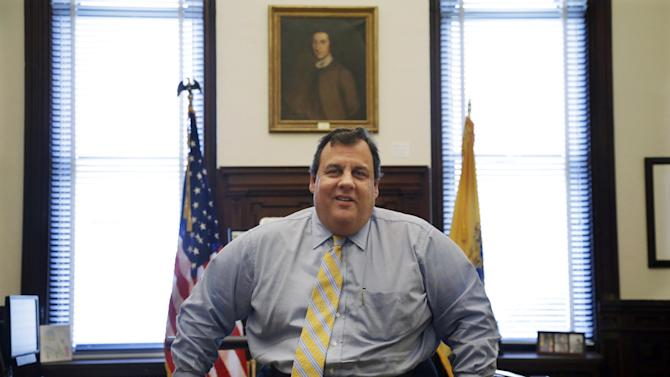In this Jan. 4, 2013, photo, New Jersey Gov. Chris Christie poses for a photo in his office at the Statehouse in Trenton, N.J. The first-term Republican has earned nearly universal praise for his handling of Superstorm Sandy, the state's worst natural disaster. But some within his own party called him out for embracing the Democratic president and hurling angry words at a fellow Republican. Christie says the storm and its aftermath should transcend politics. He says he praised the president because Obama was on the front lines helping New Jersey and he called out the speaker after 66 days had elapsed without Congress acting on the aid package. (AP Photo/Mel Evans)