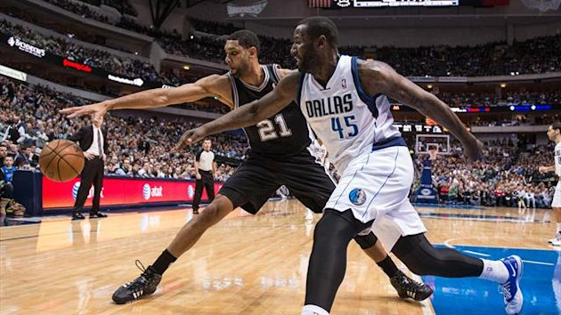 San Antonio Spurs power forward Tim Duncan (21) and Dallas Mavericks center DeJuan Blair (45) (Reuters)