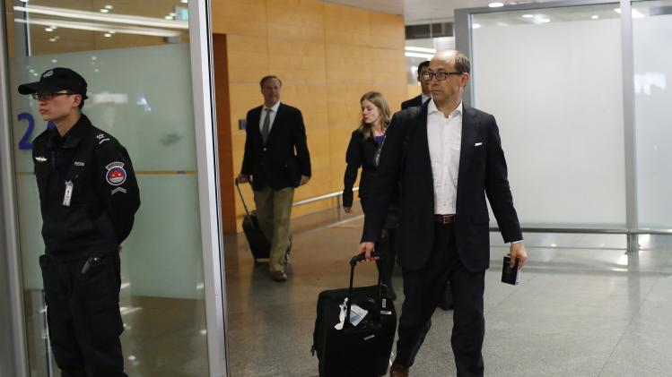 Twitter CEO Dick Costolo arrives at the Shanghai Pudong Airport in Shanghai