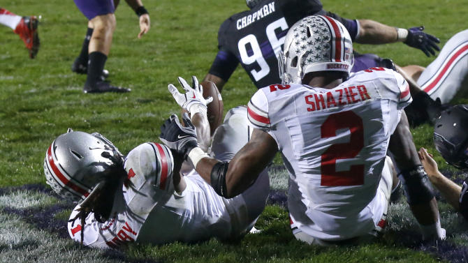 Ohio State cornerback Bradley Roby (1) recovers a blocked punt by Northwestern's Brandon Williams in the end zone for a touchdown during the first half of an NCAA football game on Saturday, Oct. 5, 2013, in Evanston, Ill. Assisting on the play is linebacker Ryan Shazier. (AP Photo/Charles Rex Arbogast)