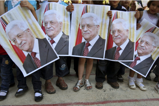Palestinian children hold posters of Palestinian President Mahmoud Abbas during a rally in  the village of Azmut near the West Bank city of Nablus, Sunday, Sept. 18, 2011. Abbas is set to address the U.N. this week, planning to ask the world to recognize a Palestinian state. (AP Photo/Nasser Ishtayeh)