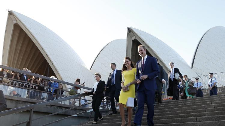 Britain's Prince William and Catherine, Duchess of Cambridge, walk during a reception at the Sydney Opera House