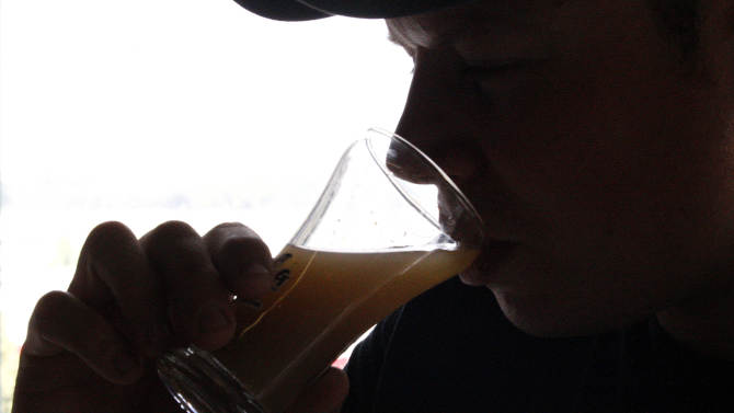 In this July 25, 2011 photo, Flying Dog Brewery's head brewer Ben Clark takes a sip of wort, a sugary liquid that is fermented by yeast to eventually create beer, at the brewery's headquarters in Frederick, Md. The company plans to end shipments to more than a dozen states beyond the east coast in order to burnish its image as a craft brewer and attract more consumers who are interested in buying local. (AP Photo/Patrick Semansky)