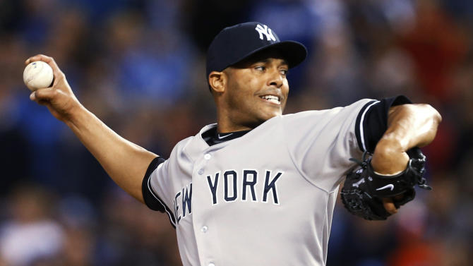 New York Yankees relief pitcher Mariano Rivera delivers to a Kansas City Royals batter during the ninth inning of a baseball game at Kauffman Stadium in Kansas City, Mo., Saturday, May 11, 2013. The Yankees defeated the Royals 3-2. (AP Photo/Orlin Wagner)