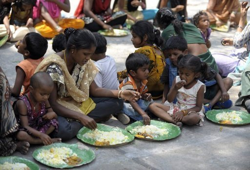 <p>Indian homeless eat food at a feeding programme for the poor in Hyderabad, on March 17, 2013. India has 55 billionaires but like other emerging economies its charitable giving still lags markedly behind that in the West where the tradition of wealthy businessmen donating chunks of their fortunes is much more deeply ingrained.</p>