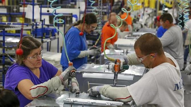 Workers assemble built-in appliances at the Whirlpool manufacturing plant in Cleveland, Tennessee August 21, 2013. REUTERS/Chris Berry/Files