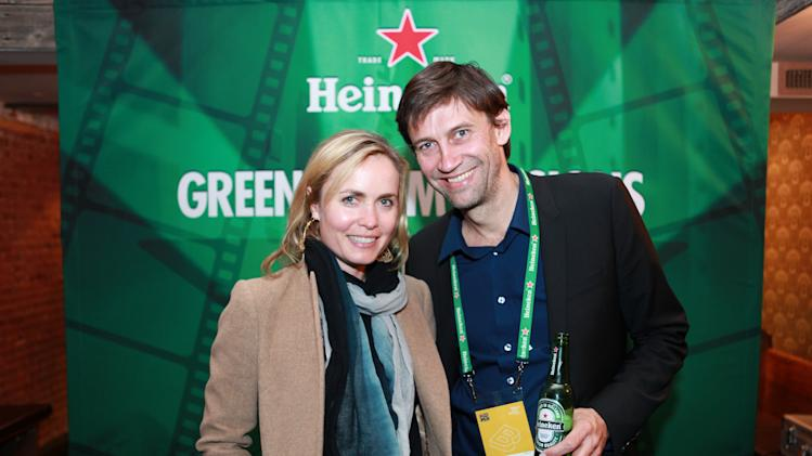 "IMAGE DISTRIBUTED FOR HEINEKEN - In this image released on Saturday, April 27, 2013, Filmmaker Nicholas Wrathall, right, of ""Gore Vidal"" with actress Radha Mitchell at Heineken's Green Room Session during Tribeca Film Festival on Friday, April 26, 2013 in New York City. (Heineken via AP Images)"