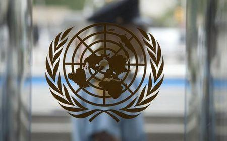 A security guard walks past the United Nations logo at the U.N. Headquarters in New York