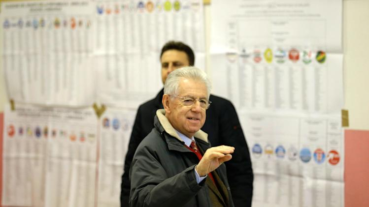 Outgoing Premier Mario Monti prepares to vote, in Milan, Italy, Sunday, Feb. 24, 2013. Italy votes in a watershed parliamentary election Sunday and Monday that could shape the future of one of Europe's biggest economies. (AP Photo/Luca Bruno)