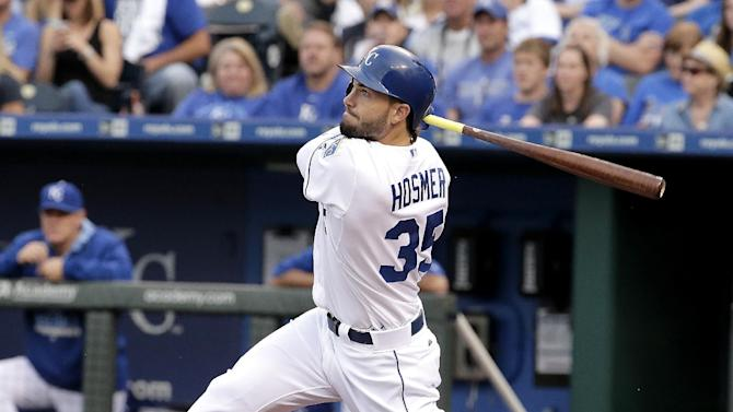 Kansas City Royals' Eric Hosmer hits a three-run home run during the first inning of a baseball game against the Cleveland Indians, Tuesday, May 5, 2015, in Kansas City, Mo. (AP Photo/Charlie Riedel)