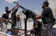 Syrian rebel fighters operate an anti-aircraft machinegun mounted on a truck in the northern city of Aleppo on August 4. Syrian regime warplanes pounded rebel positions in Aleppo on Sunday ahead of a threatened ground assault by more than 20,000 troops assembled around the commercial capital