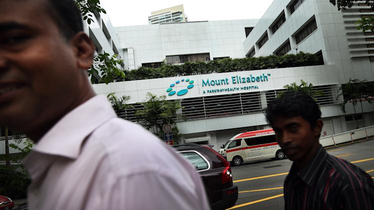 People walk past the Mount Elizabeth Hospital in Singapore Thursday, Dec. 27, 2012. A young woman who was gang-raped and assaulted on a moving bus in the Indian capital was flown Thursday to the Singapore hospital for treatment of severe internal injuries that could last several weeks, officials said. (AP Photo/Wong Maye-E)