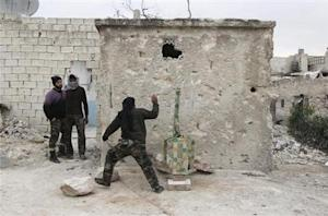 A member of the Free Syrian Army runs after placing a mortar shell inside a launcher during what activists said were clashes with pro-government forces, beside Hanano barracks in Aleppo's Karm al-Jabal district