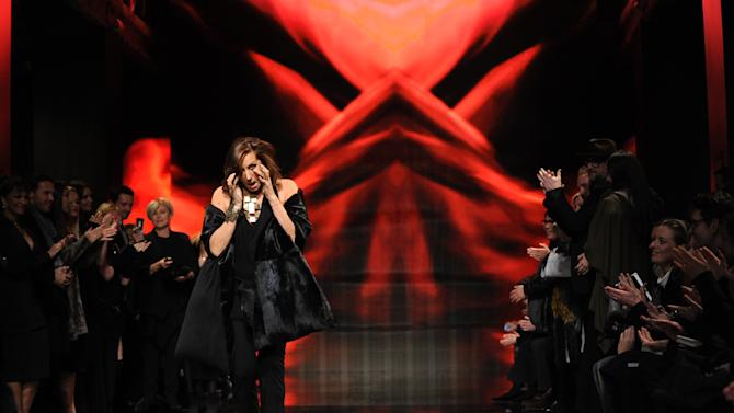 Designer Donna Karan wipes her eyes after the Donna Karan New York Fall 2014 collection was presented during Fashion Week, Monday, Feb. 10, 2014, at 23 Wall Street in New York. (AP Photo/Diane Bondareff)