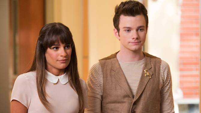 """This photo released by Fox shows, Lea Michele, left, and Chris Colfer, in a scene from """"Glee."""" The media advocacy group GLAAD on Wednesday, Oct. 1, 2014, released its annual report on diversity on TV, including depictions of gay characters. (AP Photo/Fox, Eddy Chen)"""