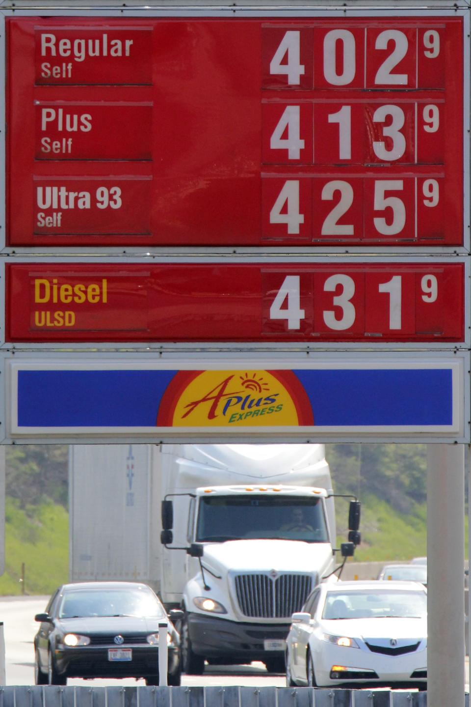 In this April 15, 2012 photo, gasoline prices greet motorists at the Midway Plaza on the Pennsylvania Turnpike in Bedford, Pa. It's Memorial Day weekend and our obsession with the price of gasoline is in focus again. (AP Photo/Gene J. Puskar)