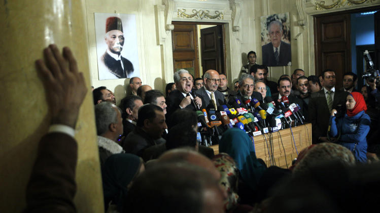 Former Egyptian presidential candidate, Hamdeen Sabahi, center left, speaks during a press conference following the meeting of the National Salvation Front as former director of the U.N.'s nuclear agency and Nobel peace laureate, Mohamed El Baradei, center, and former Egyptian Foreign Minister and presidential candidate, Amr Moussa, center right, listen in Cairo, Egypt, Monday, Jan. 28, 2013. Egypt's main opposition coalition has rejected the Islamist president's call for dialogue to resolve the country's political crisis, unless their conditions are met. (AP Photo/Amr Nabil)