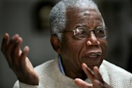 FILE - This is a Tuesday, Jan. 22, 2008 file photo of Chinua Achebe, Nigerian-born novelist and poet as he speaks about his works and his life at his home on the campus of Bard College in Annandale-on-Hudson, New York where he is a professor . Nigerian author Chinua Achebe, who wrote the classic &quot;Things Fall Apart,&quot; has died. He was 82. Achebe&#39;s publisher confirmed his death Friday March 22, 2013. (AP Photo/Craig Ruttle)