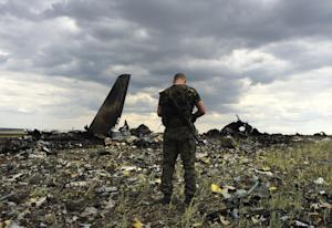 A pro-Russian fighter guards the site of remnants of…