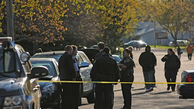 Police investigate the scene where three people were shot and killed at an in-home day care in Brooklyn Park, Minn., on Monday, April 9, 2012. No arrests were immediately made. (AP Photo/The Star Tribune, Richard Sennott)  MANDATORY CREDIT; ST. PAUL PIONEER PRESS OUT; MAGS OUT; TWIN CITIES TV OUT where three people were shot and killed at an in-home day care in Brooklyn Park,  Minn., on Monday, April 9, 2012. No arrests were immediately made. (AP Photo/The Star Tribune, Richard Sennott)  MANDATORY CREDIT; ST. PAUL PIONEER PRESS OUT; MAGS OUT; TWIN CITIES TV OUT