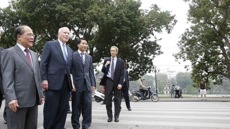 Vietnam's National Assembly Chairman Nguyen Sinh Hung guides U.S. Senate Judiciary Committee Chairman Patrick Leahy as they walk around Hoan Kiem lake in Hanoi