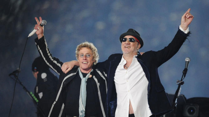 """FILE - In this Feb. 7, 2010 file photo,Roger Daltrey, left, and Pete Townshend acknowledge the crowd after performing during the second half of the NFL Super Bowl XLIV football game in Miami. Townshend and Daltrey are taking the band on the road for a series of shows in the U.K. celebrating its 50th anniversary. Daltrey suggested it would be their last major tour, referring it to the start of their """"long goodbye"""" during a news conference Monday, June 30, 2014, at Ronnie Scott's jazz bar in London. (AP Photo/Mark J. Terrill, file)"""