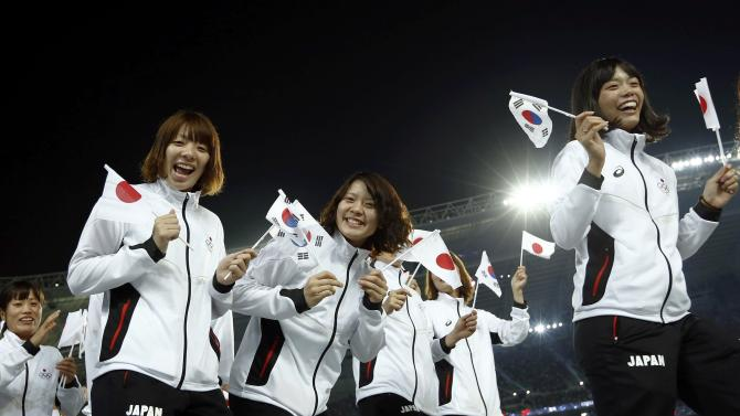 Japanese athletes wave to the crowd during the Opening Ceremony of the 17th Asian Games in Incheon