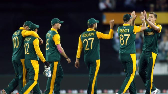 South Africa's Morne Morkel celebrates with teammates after dismissing Ireland's Andrew Balbirnie for 58 runs during their Cricket World Cup match at Manuka Oval in Canberra